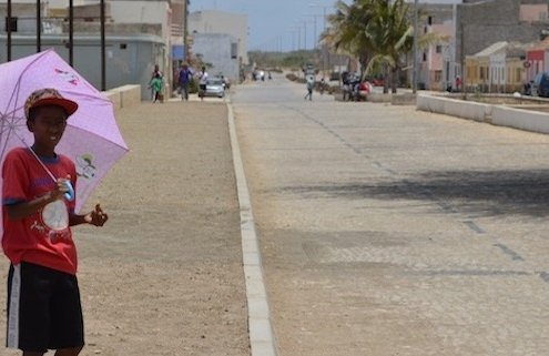 Boy with umbrella, Maio, Cape Verde